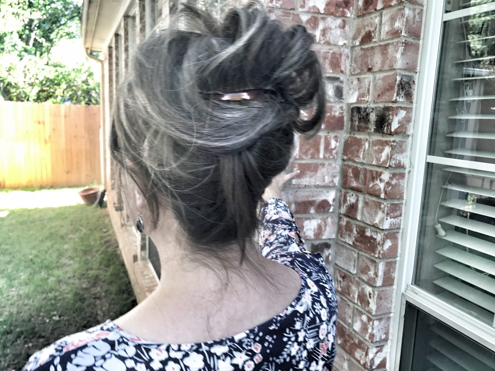 Hair topper in updo back view